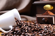 Cup of coffee with beans front view