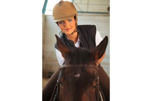 Woman In Indoor Riding Arena