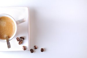 Cup with spoon and coffee beans