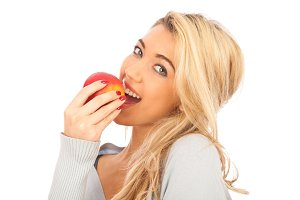 Young Woman Enjoying An Apple