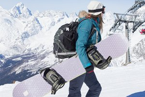 Snowboarder girl the mountains.