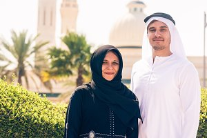 Arabian Couple Standing In Front Of Mosque