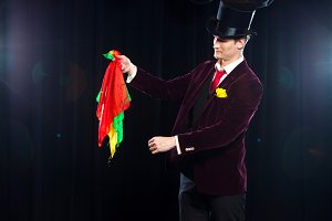 Magician, Juggler man, Funny person, Black magic, Illusion focus with colored cloth with cloths