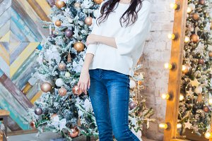 Christmas. Beautiful smiling girl. Over christmas tree lights background. happy new year.