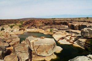 Rocky pond on Adrar plateau, Mauritania