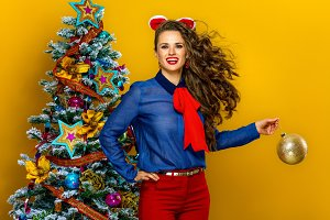 happy trendy woman woman holding Christmas ball