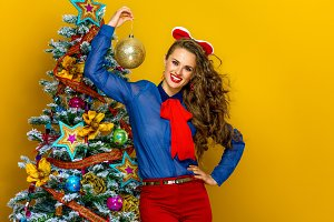 happy trendy woman showing Christmas ball