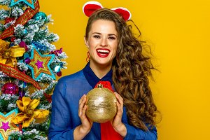 smiling elegant woman holding Christmas ball