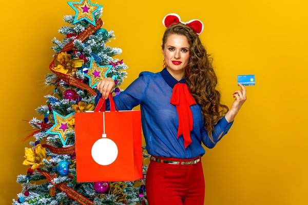Woman Showing Christmas Shopping Bag And Credit Card High Quality Holiday Stock Photos Creative Market