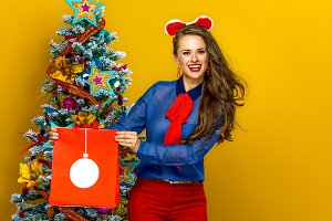 happy young woman showing Christmas shopping bag