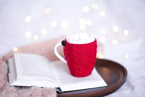 Cup of coffe with book