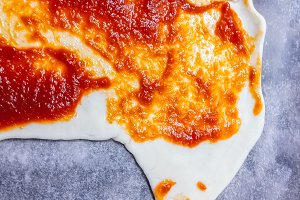 Pizza dough with tomato