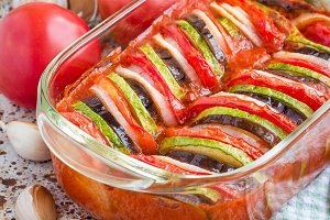 Homemade vegetable ratatouille in glass dish, cooked in oven, square