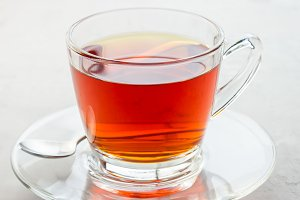 Healthy herbal rooibos red tea in glass cup, square