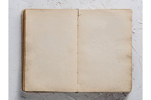 Open book blank on white concrete background