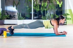 fitness training athletic sporty woman doing plank exercise in gym or yoga class concept exercising workout aerobic