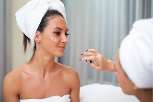 Home spa beauty pure clean skin care women applying facial homemade mask