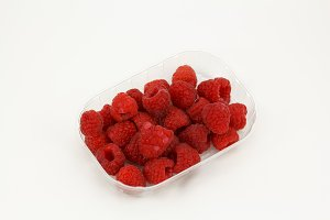 Raspberries in plastic box