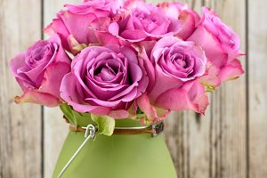 Pink roses in a vase on the table