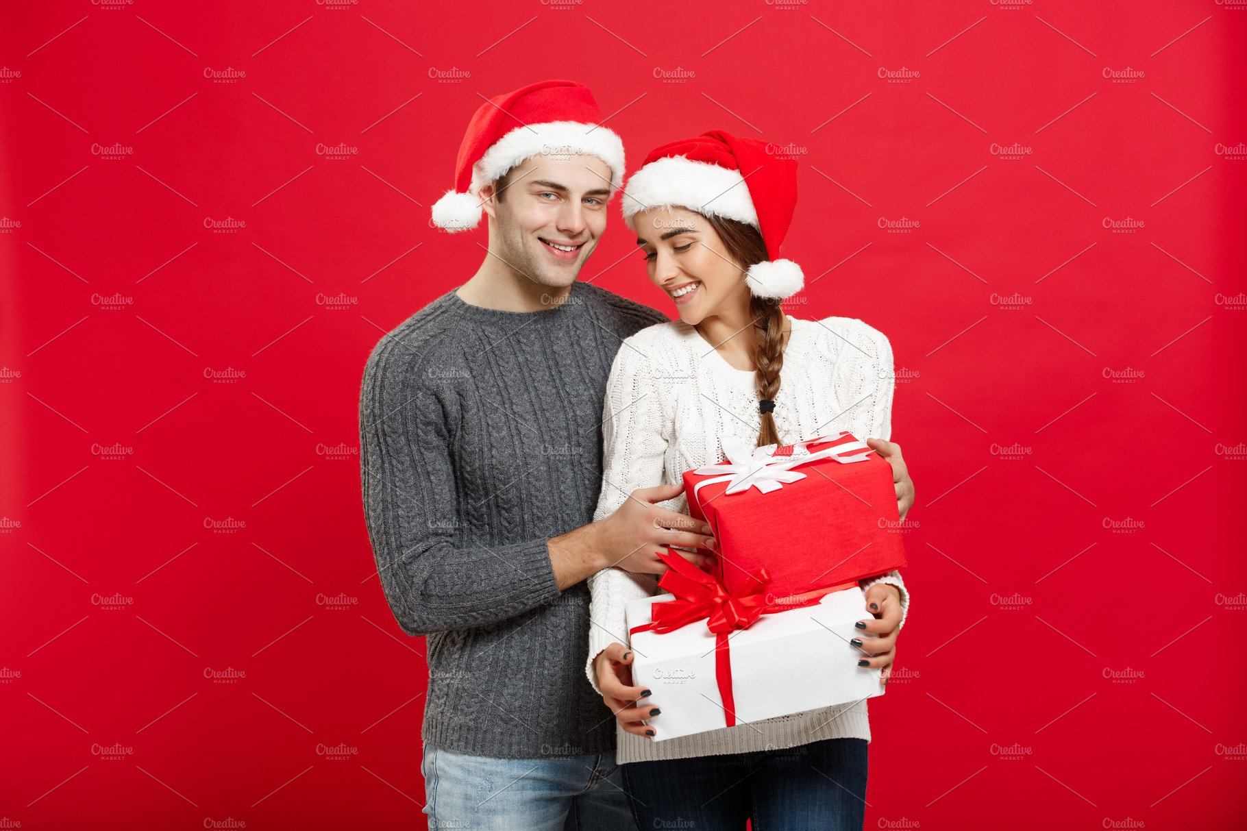 Christmas Concept - portraiit young couple in Christmas sweater ...
