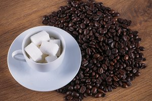 Coffee cup sugar and coffee beans