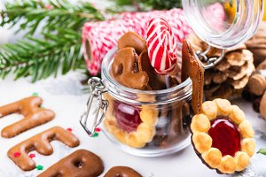 Christmas cookies on festive decorated background