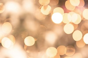 Bokeh lights glam golden background