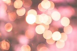 Bokeh lights rose gold background
