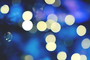 Bokeh lights dark blue background