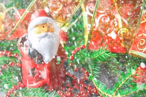 Christmas toy Santa Claus surrounded by fir branches.