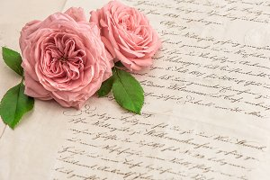 Pink roses and handwritten letters