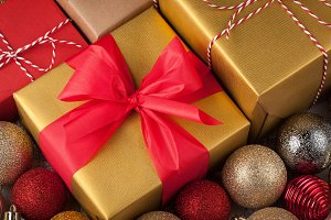 Colored boxes with gifts in a festive box with Christmas decorations. Top view