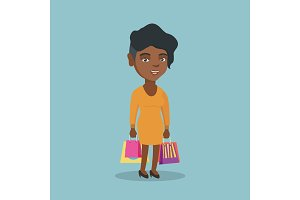 Young african-american woman with shopping bags.
