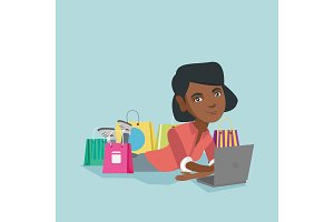 Young african-american woman doing online shopping