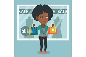 Young african-american woman shopping on sale.