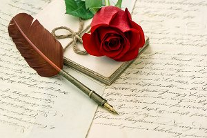 Old letters and rose flower