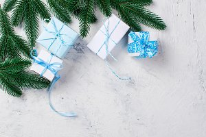Christmas fir branches and gifts box