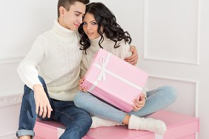 Loving couple of teens and gifts