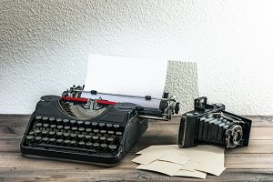 Typewriter and vintage photo camera