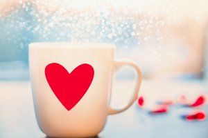 Mug with red heart and bokeh