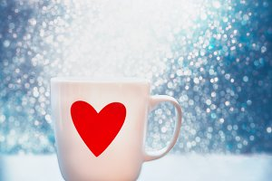 Mug with red heart at blue