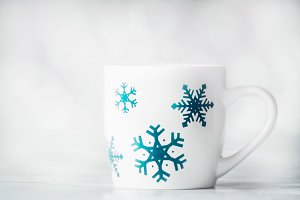 Winter holidays mug and snowflakes