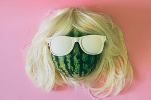watermelon with wig and sunglasses