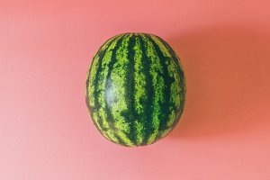 raw striped round watermelon