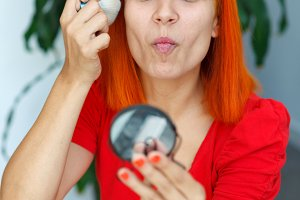 Red hair woman woman getting makeup
