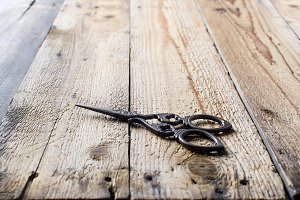 scissors on a wooden table