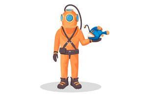 Deep sea diver in pressure suit holds sea devil fish
