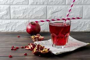 Pomegranate juice in glass and pomeg