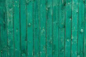 Dark lime vintage wooden boards. Backgrounds and textures fence painted. Front view. Attract beautiful vintage background.