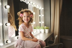 cute little girl making make-up